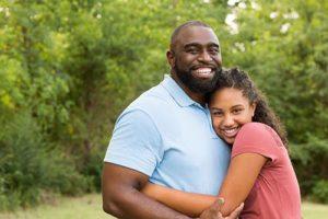 father and daughter happy providing Falcon Ridge Ranch testimonials