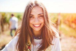 girl smiling at the Falcon Ridge Ranch campus